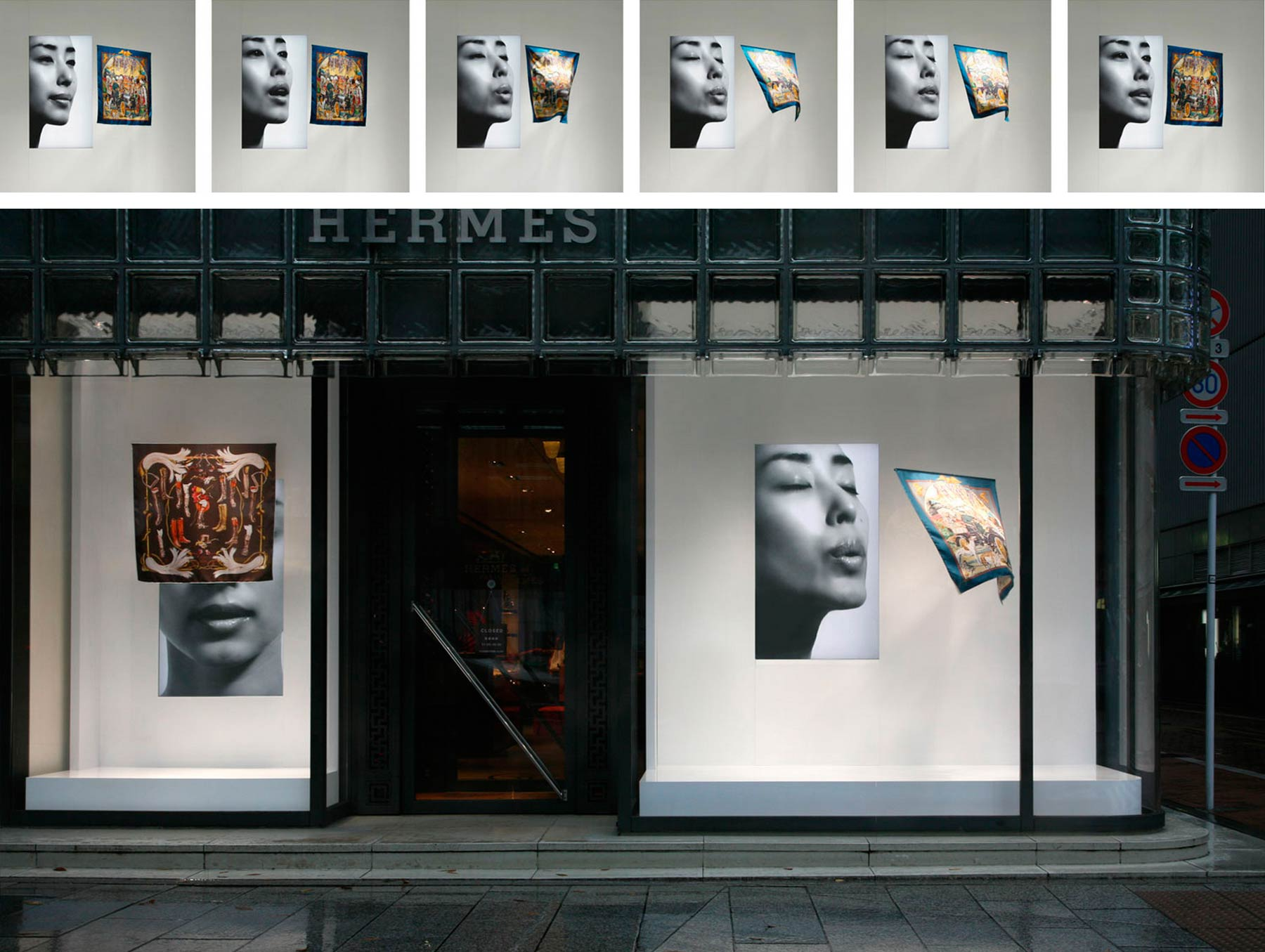 A shop window with television screens and kerchiefs hanging. The image on the screen is a woman's face blowing. The kerchief is animated by the woman's blow out.