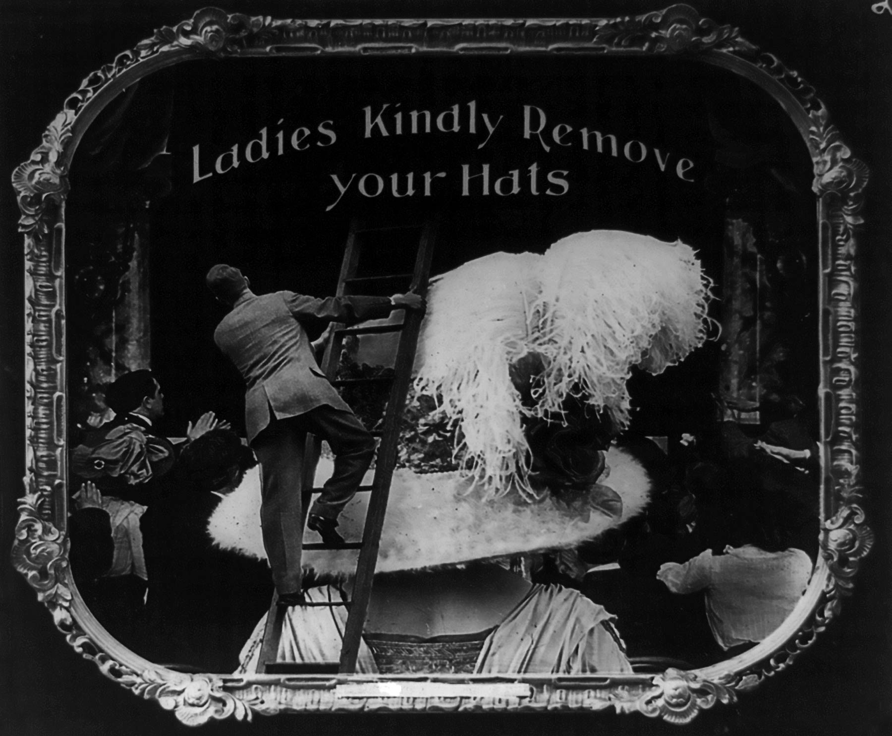 Black and white collage. A man stands on a ladder, which is on a feminine hat on a giant woman's head. He is trying to watch a cinema screen. Text reads: Ladies kindly remove your hats