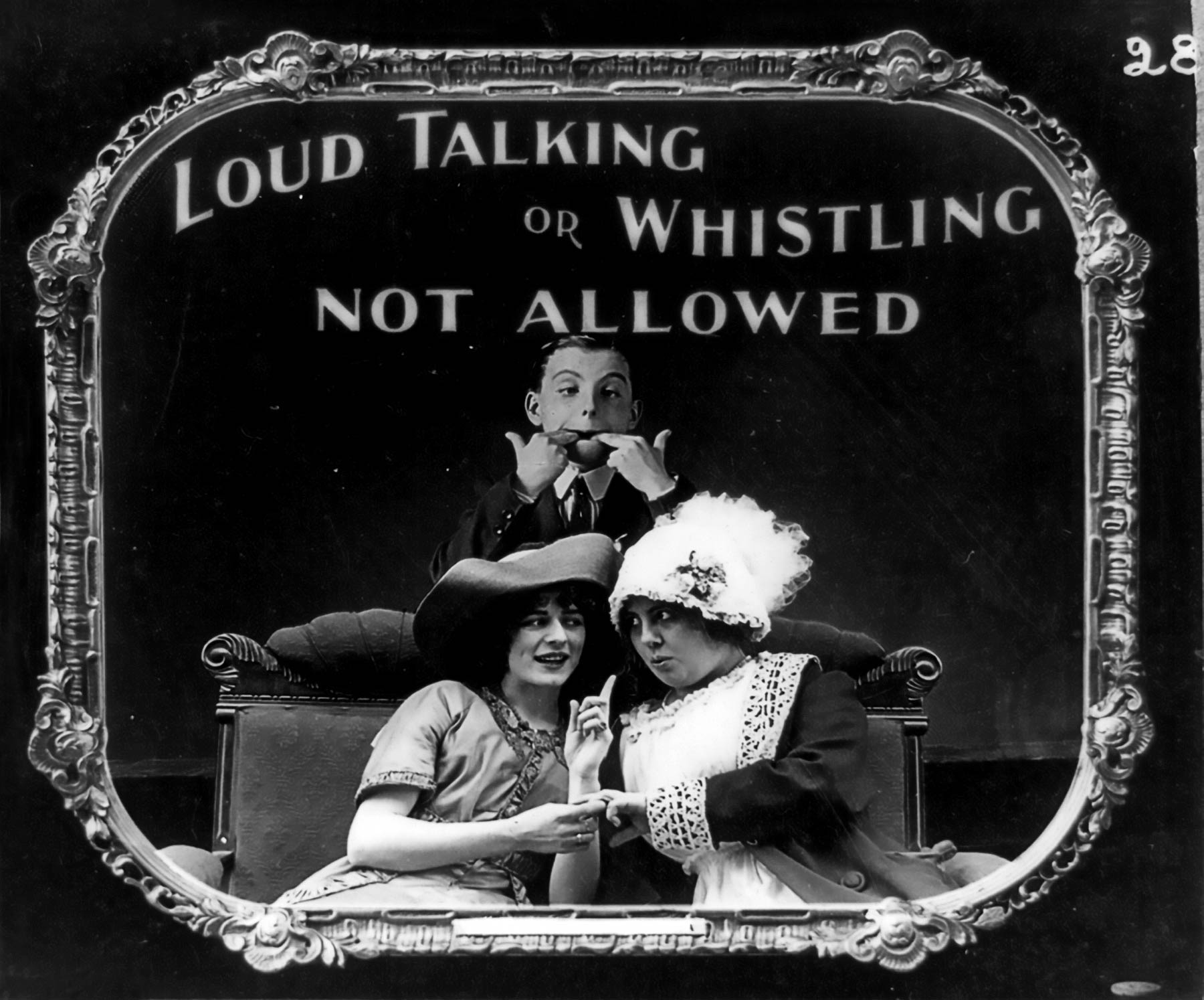 An old picture portraying three people. One of them is whistling, the other two are chattering. Text says: Loud talking or whistling not allowed