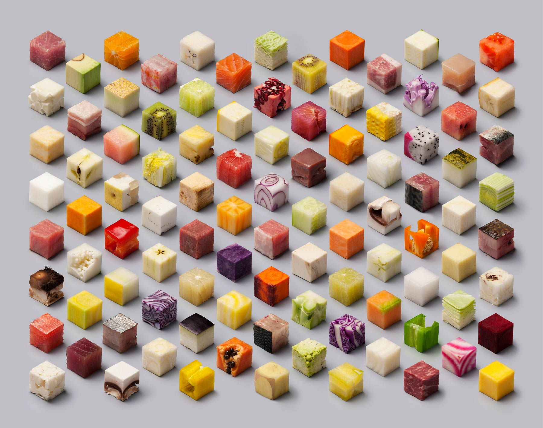 A series of cubes cut out inside food: vegetables, fruit, fish…